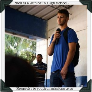 young man speaking on a missions trip