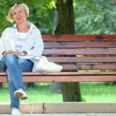 woman on bench considering how to be unique