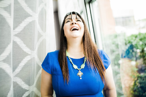 marye audet-white laughing in a blue dress