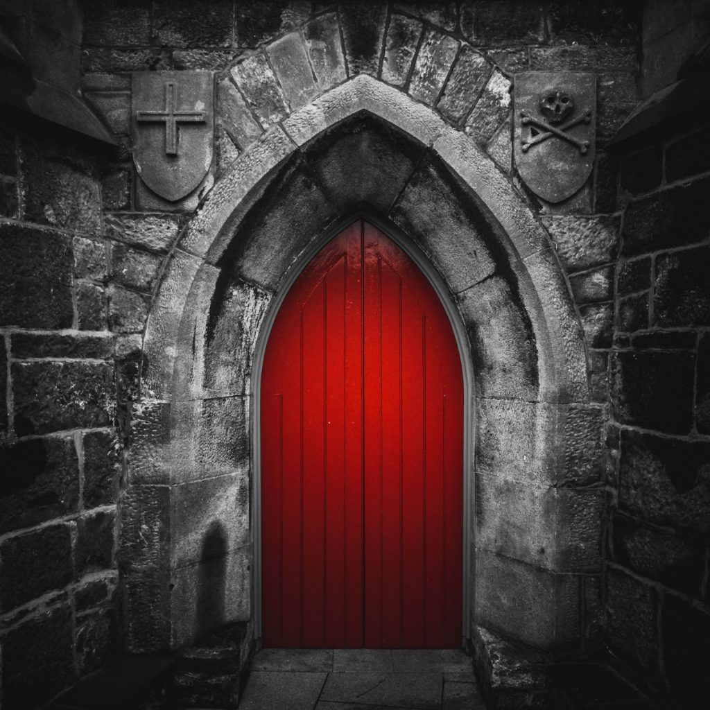 A red door in a gray castle wall - illustration for post